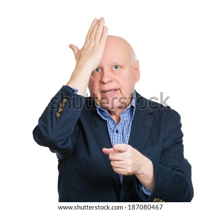 Closeup portrait goofy, senior, mature, old business man slapping hand on head, duh, isolated white background. Negative human emotions, facial expression, feelings, body language, reaction to mistake - stock photo