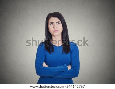 Closeup portrait grumpy annoyed, sad, unhappy, dissatisfied young woman, wife, employee, customer, isolated grey wall background. Human face expressions, emotions, reaction, attitude, perception  - stock photo