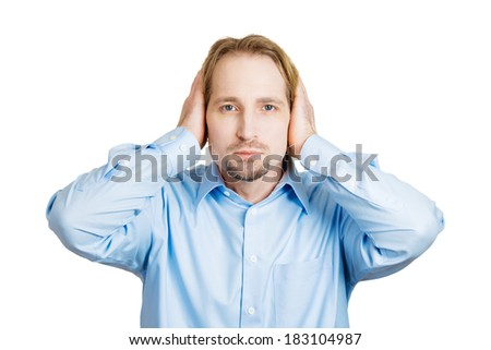 Closeup portrait handsome peaceful, tranquil, looking relaxed, young business man covering his ears, observing, isolated white background. Hear no evil concept. Human emotion, facial expressions - stock photo