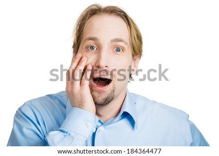 Closeup portrait handsome, startled, surprised, shocked, stunned young man, in full disbelief, hand on face, isolated, white background. Human face expressions, emotions, reaction, perception - stock photo
