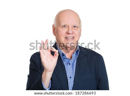 Closeup portrait, happy, confident, cheerful, smiling senior mature man showing OK sign gesture, isolated white background. Positive human emotions, facial expressions, feelings, attitude - stock photo
