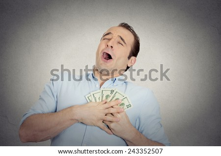 Closeup portrait happy excited successful business man in love with money, funny looking guy holding dollar bills in hand isolated grey wall background. Human emotions, facial expressions, feeling - stock photo