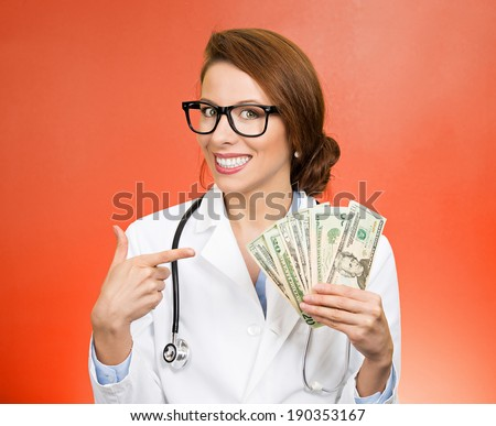 Closeup portrait, happy, health care professional, business woman, doctor holding dollar bills, cash, money in hand, isolated red background. Human emotions, facial expressions, attitude, finances - stock photo