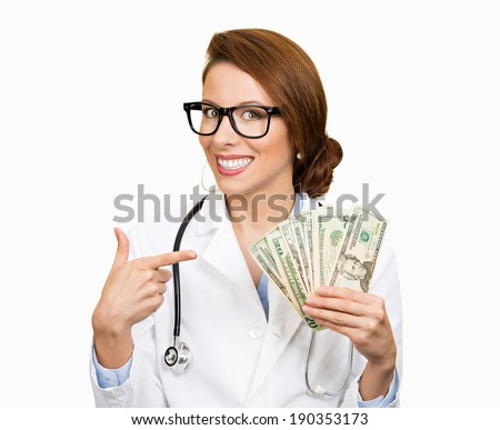 Closeup portrait, happy, health care professional, business woman, doctor holding dollar bills, cash, money in hand, isolated white background. Human emotions, facial expressions, attitude, finances - stock photo