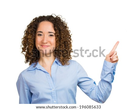 Closeup portrait happy pretty confident young smiling woman gesturing to space at right with finger isolated white background. Positive human emotion, signs symbol, facial expression feeling attitude - stock photo