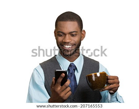 Closeup portrait happy smiling business man reading good news on smart phone, lawyer holding mobile, drinking cup coffee isolated white background. Human face expression, emotion, corporate executive  - stock photo