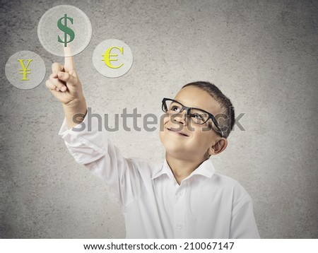 Closeup portrait happy, smiling Child Touching Selecting Dollar sign button on currency Exchange Touchscreen display, grey wall background. Positive face expression, emotions. Financial concept - stock photo