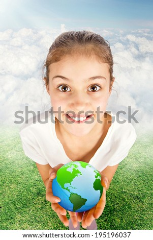 Closeup portrait happy, smiling little girl holding world globe isolated green grass, clouds, sky  background. Positive human emotions, facial expression, life perception, attitude, feelings - stock photo