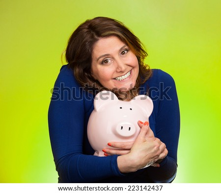 Closeup portrait happy smiling middle aged business woman holding piggy bank excited to save cash isolated green background. Financial savings, banking concept. Positive emotion face expression - stock photo