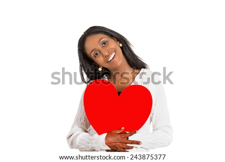 Closeup portrait happy smiling pretty middle aged woman looking excited holding large red heart to chest daydreaming of men in love isolated white background. Positive emotion face expression feeling - stock photo