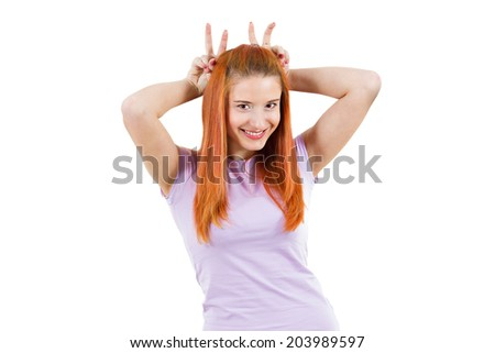 Closeup portrait happy teen girl ecstatic woman in a great mood, making bunny ears isolated white background. Positive human emotions, facial expressions, reaction, attitude, life perception, attitude - stock photo