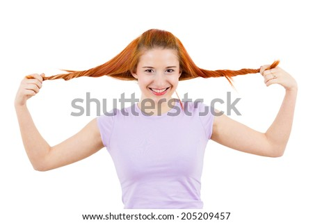 Closeup portrait happy teen girl ecstatic woman in a great mood, pulling her hair ponytails isolated white background. Positive human emotions, facial expressions, reaction, attitude, life perception - stock photo