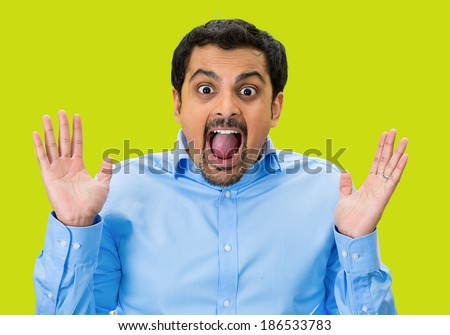 Closeup portrait, happy young handsome man looking shocked surprised in full disbelief hands in air open mouth eyes, isolated green background. Positive human emotion facial expression feeling - stock photo