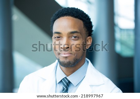 Closeup portrait head shot of friendly, smiling confident male healthcare professional with a white coat, isolated hospital clinic background. - stock photo