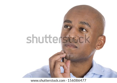 Closeup portrait head shot of handsome man, young corporate executive, worker, businessman, daydreaming, thinking looking up and to side , isolated on white background. Human emotions.Face expression - stock photo