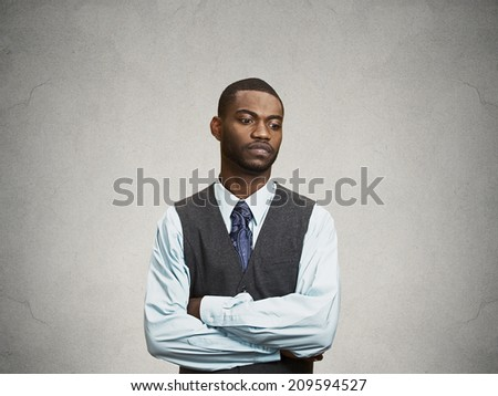 Closeup Portrait, headshot angry, Annoyed handsome Business Man avoiding eye contact, tired of fruitless conversation looking to right, isolated grey wall background with copy space. Body language - stock photo