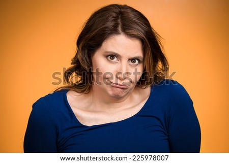 Closeup portrait headshot displeased, pissed off, angry, grumpy middle aged woman with bad attitude looking at you isolated orange background. Negative human emotions, facial expressions, feelings - stock photo