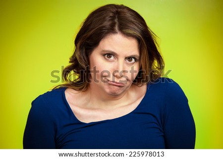 Closeup portrait headshot displeased, pissed off, angry, grumpy middle aged woman with bad attitude looking at you isolated green background. Negative human emotions, facial expressions, feelings - stock photo
