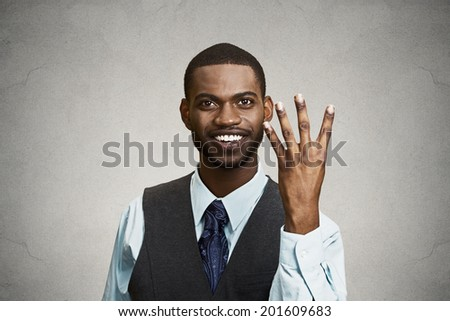 Closeup portrait, headshot, happy, smiling young man making four times sign gesture with hand fingers, isolated black grey background. Positive emotions, facial expressions, feelings, attitude, symbol - stock photo