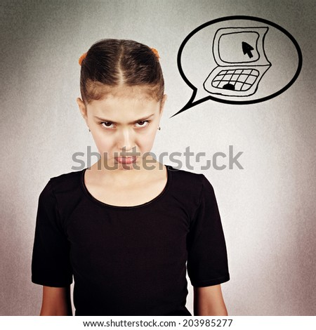 Closeup portrait, headshot little girl, unhappy, grumpy, displeased offended isolated black background with computer bubble. Negative human face expression, emotion, feeling, attitude, life perception - stock photo
