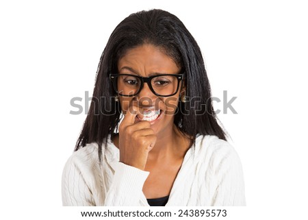 Closeup portrait headshot nervous woman with glasses biting her fingernails craving for something, anxious, isolated white background. Negative human emotion facial expression feeling body language - stock photo