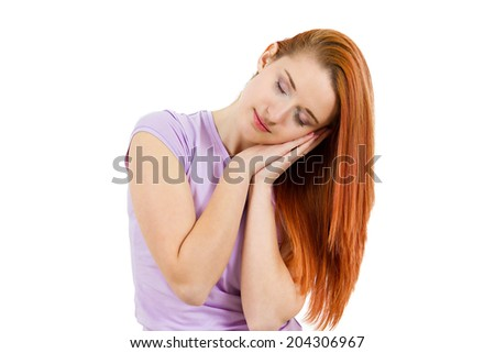 Closeup portrait, headshot sleepy, calm young woman, laying face on hands, low energy, sleeping isolated white background. Human facial expressions, emotions, feelings, reaction, body language - stock photo