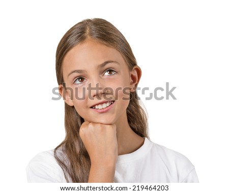 Closeup portrait, headshot thinking, daydreaming child, smiling girl, head on fist, looking up, isolated white background. Positive human facial expression, emotions, feelings, life perception - stock photo