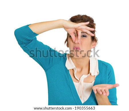 Closeup, portrait, headshot unhappy woman who covers her nose, looks displeased, disgusted, something stinks, bad smell situation, isolated white background. Human facial expressions, emotion reaction - stock photo