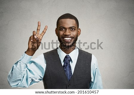 Closeup portrait, headshot young man, student holding up peace, victory, two sign , isolated black background. Positive human emotion, facial expressions, symbols, attitude communication. Life success - stock photo