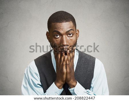 Closeup portrait, headshot young tired, fatigued business man worried, stressed, dragging face down with hands, isolated black, grey background. Negative human emotions, facial expressions, feelings - stock photo