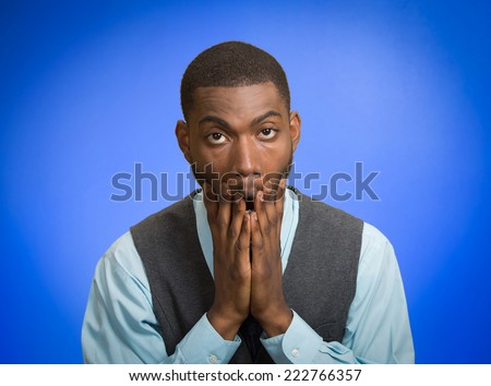 Closeup portrait, headshot young tired, fatigued business man worried, stressed, dragging face down with hands, isolated blue background. Negative human emotion facial expression feeling, perception - stock photo