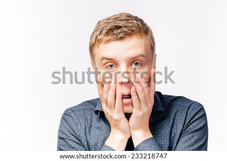 Closeup portrait, headshot young tired, fatigued business man worried, stressed, dragging face down with hands. Negative human emotions, facial expressions, feelings - stock photo