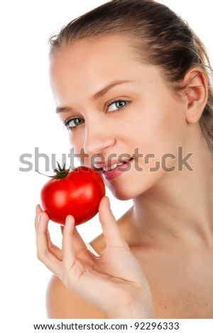 closeup portrait if beauty young woman in yellow shirt with tomato, woman holding ripe tomato,  juiced red tomato, white background - stock photo
