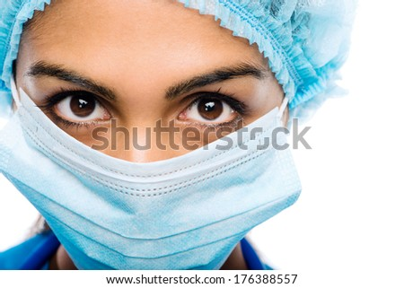 Closeup portrait Indian woman Doctor surgeons serious white background - stock photo