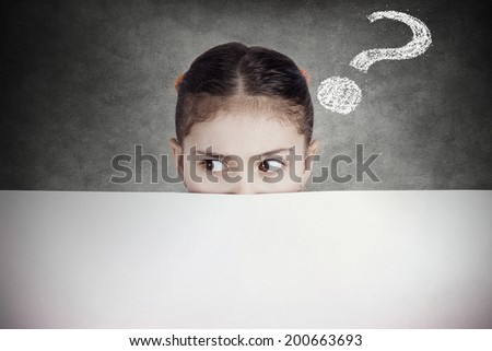 Closeup portrait little girl, suspicious, scared, cautious, curious, hiding behind blank white paper billboard, blank sign, space for text looking side way isolated black background with question mark - stock photo