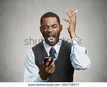 Closeup portrait mad pissed off business man, corporate executive holding smart phone screaming, irritated upset about situation isolated black background. Negative emotion, facial expression reaction - stock photo