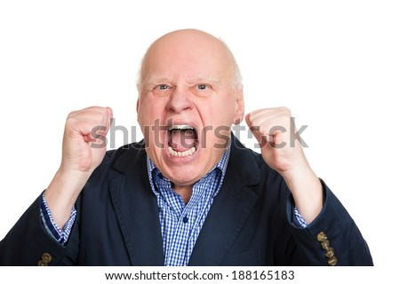 Closeup portrait, mad, upset, senior mature man, funny looking business man, fists in air, open mouth yelling, isolated white background. Negative human emotion facial expression, reaction - stock photo