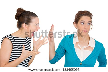 Closeup portrait, mad woman nagging complaining to other lady who is getting pissed off annoyed, isolated white background. Negative human emotion facial expression feelings. Interpersonal conflict - stock photo