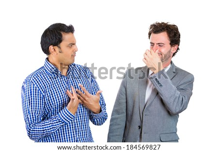 Closeup portrait, man looking at guy closing, covering nose, something stinks, very bad smell, odor. Male asks me? Isolated white background. Negative human emotion, facial expression, feeling - stock photo