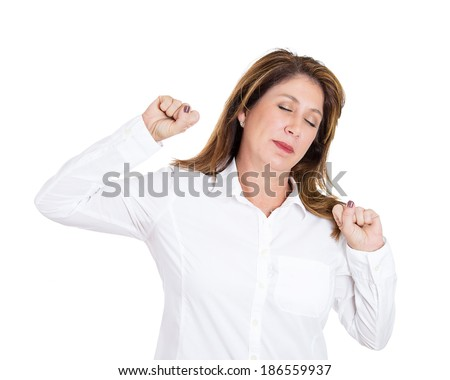Closeup portrait, mature, tired fatigued woman stretching extending arms, back, shoulders, waking up, isolated white background. Positive human emotion facial expression feeling - stock photo