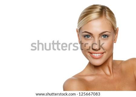Closeup portrait of a beautiful blond female model on white background - stock photo