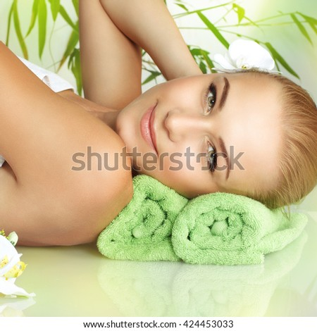 Closeup portrait of a beautiful gentle woman relaxing on a massage table, medical therapy in a beauty salon, healthy lifestyle, enjoying dayspa on a luxury spa resort - stock photo