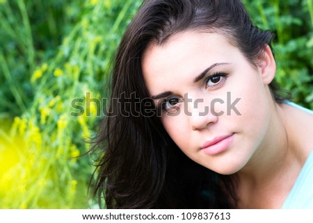 Closeup portrait of a beautiful girl on nature - stock photo