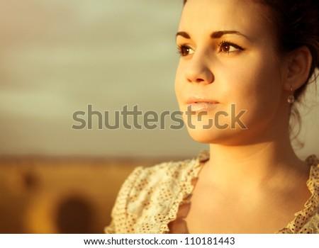 Closeup portrait of a beautiful girl on nature. Toned image - stock photo