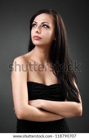 Closeup portrait of a beautiful hispanic woman standing with crossed arms - stock photo