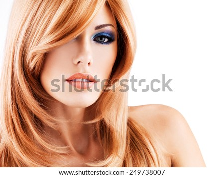 Closeup portrait of a beautiful woman with long red hairs and blue eye makeup - isolated on white background - stock photo