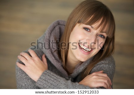 Closeup portrait of a beautiful young woman laughing - stock photo