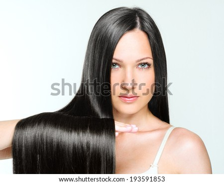 closeup portrait of a beautiful young woman with elegant long shiny hair. hairstyle. isolated on white background. - stock photo