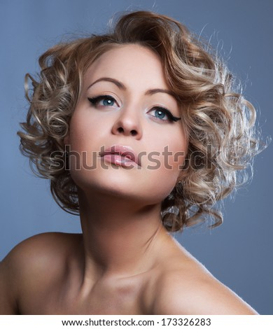 closeup portrait of a beautiful young woman with elegant shiny hair - stock photo