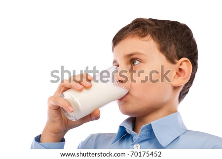 Closeup portrait of a boy drinking a glass of milk, isolated on white background - stock photo